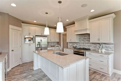 Kitchen With White Cabinets And White Island-home And