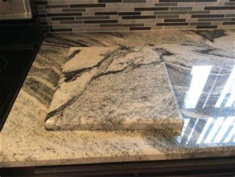 silver cloud granite countertops  backsplash tiles