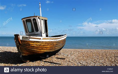 Old Boat On Beach Images by Old Fishing Boat Named Julie On Deal S Pebble Beach Kent