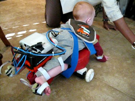Robot Assistants for Promoting Crawling and Walking in