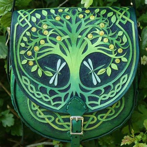 sold tree  life carved leather bag handmade  sky raven