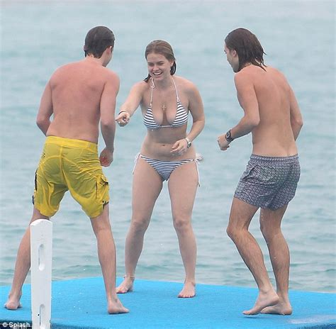 Alice Eve parades her showstopping curves in a nautical striped bikini