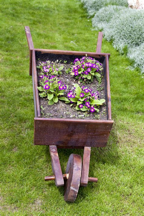 wheelbarrow planter ideas 27 wheelbarrow flower planter ideas for your yard
