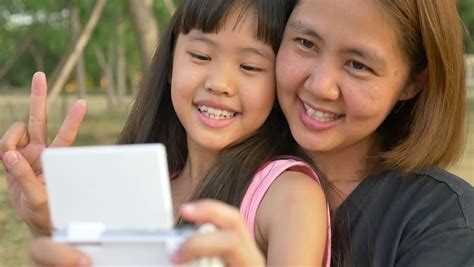 Stock Video Clip Of Asian Mother And Daughter Taking Selfie Photograph Shutterstock
