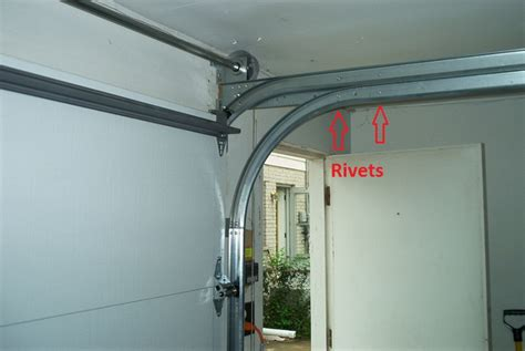 garage door tracks converting from low headroom tracks to high lift
