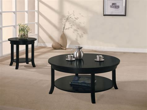 As a place to set your drink while socializing or rest. Black Coffee Table Design Images Photos Pictures