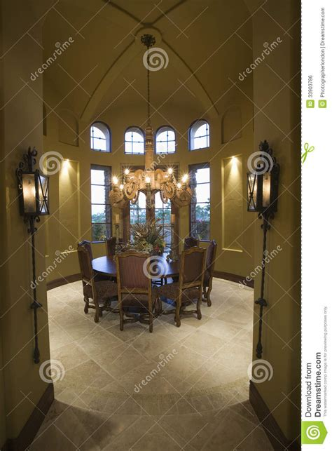 chandelier hanging dining table in house royalty free