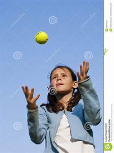 Young Girl Throwing Tennis Ball Stock Photography - Image ...