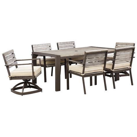 outdoor dining table set with swivel chairs by signature