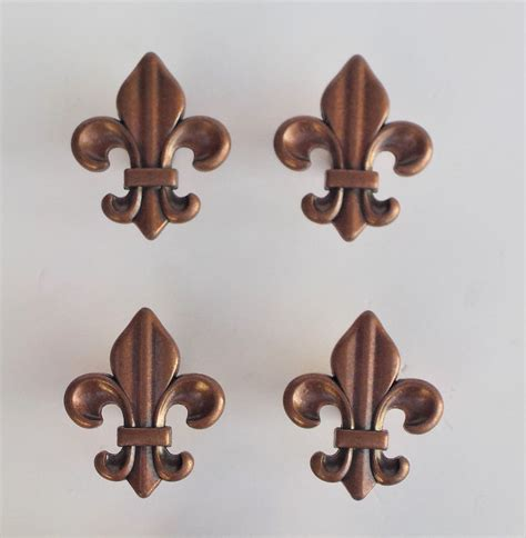 fleur de lis cabinet hardware set four 4 copper colored cabinet drawer pulls fleur