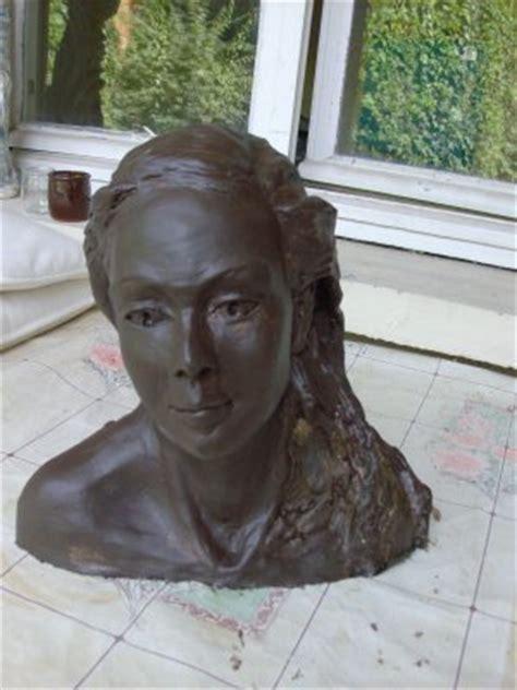tete de femme sculpture en terre cuite patinee