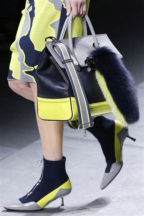 Gigi Hadid Suffers Nip Slip as she Models Versace Pump-Boots