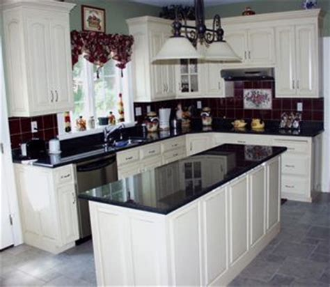 kitchen with black countertops and white cabinets imagine with white granite on wall cabinets on 9849