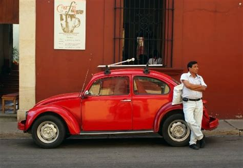 Mexican Man Waiting At His Volkswagen Beattle, One Of