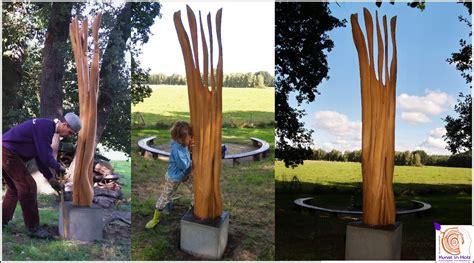 stehle mit holzstamm outdoor skulptur gedankenlos 2009 09 kunst in holzkunst in holz