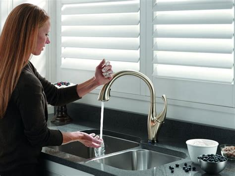 touch activated water faucet