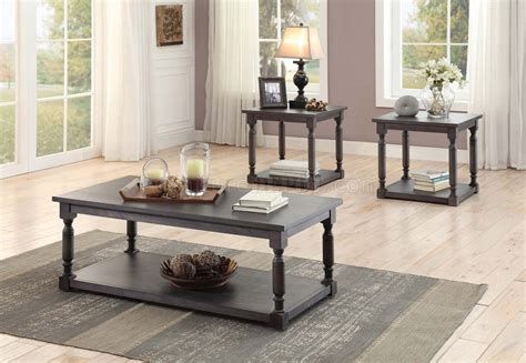 Open on two sides, the outer sheet metal structure features a bronze satin finish, while its interior is clad entirely in exotic sucupira veneer, stained mink color, for a stunningly elegant effect. Amaryllis 3560-31 Coffee Table 3Pc Set Dark Grey by Homelegance