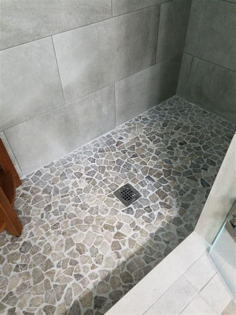 large stone grey mosaic pebble tile shower flooring
