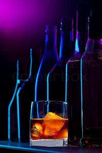 Alcohol drink with ice and silhouette of the different ...