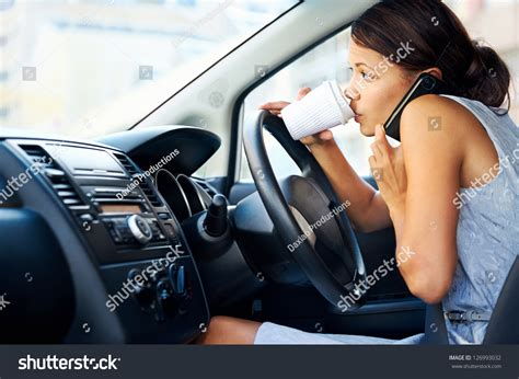 businesswoman multitasking while driving coffee