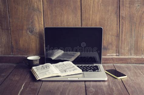 laptop open book cell phone  coffee mug stock photo