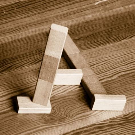 wood block letters optical illusion alphabet