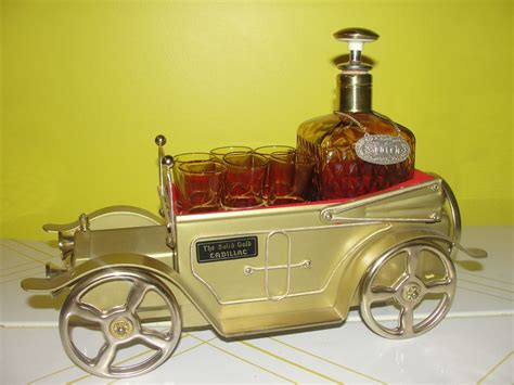 ''the Solid Gold Cadillac'' Decanter And Glasses With