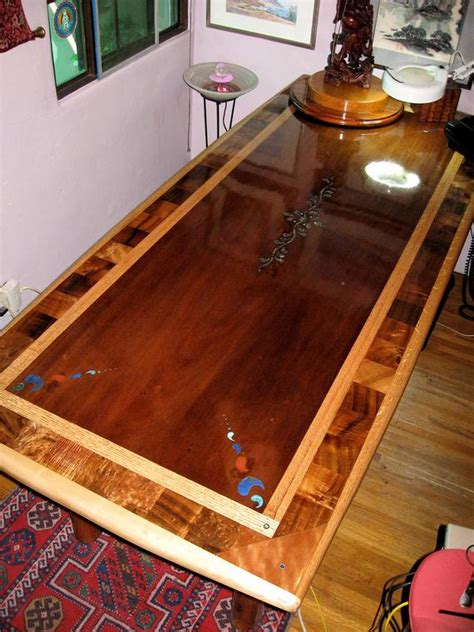 custom laminated exotic hardwood dining table  inlay