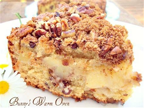 This sour cream coffee cake is a tender crumb cake with cinnamon pecan topping. Apple Nut Sour Cream Coffee Cake - Bunny's Warm Oven