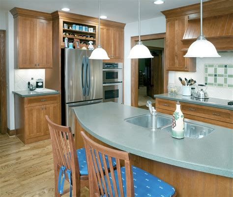 green corian a kitchen remodel with maple cabinets soft green corian