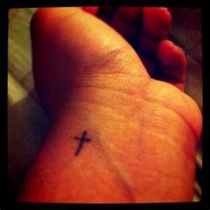 Tiny & simple Christian cross tattoo on wrist