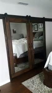 standing mirror barn doors and closet on