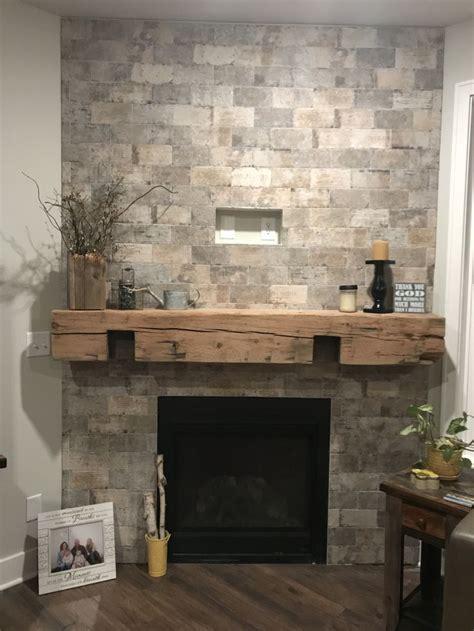 tile brick fireplace  barnwood mantle fireplace