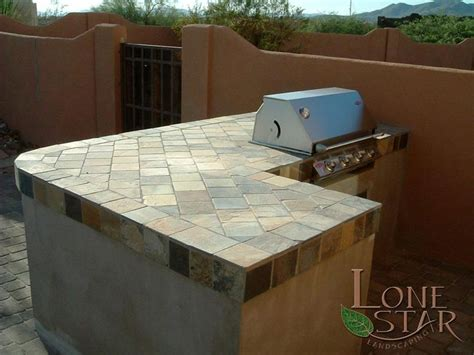 outdoor kitchen tile this barbecue island has a large slate tile countertop in 1309