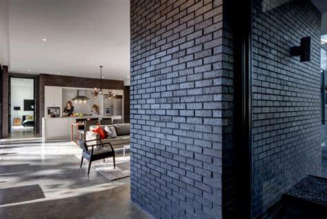 black brick house texas house with dramatic black brick cladding digsdigs