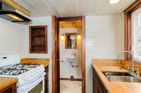 the sheriff tiny house on wheels boasts a walk in closet