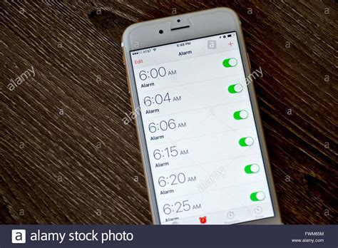 set an alarm on my phone an apple iphone 6s displaying the alarm clock application