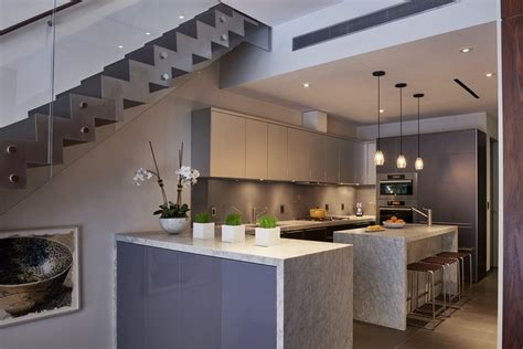 kitchen table with cabinets underneath what are waterfall kitchen islands and how do i use them