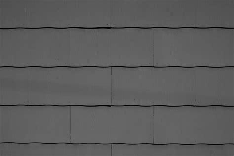 charcoal gray scalloped asbestos siding shingles texture