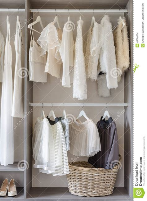 row of white dress in wardrobe at home stock image