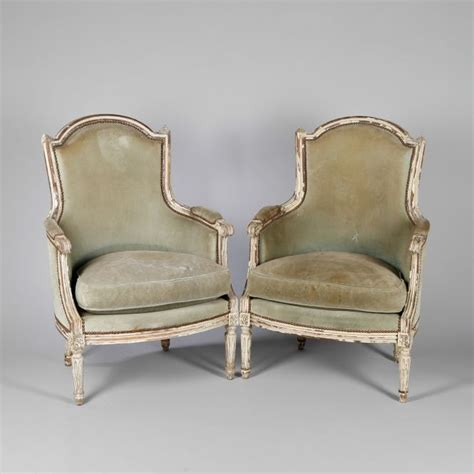 pair of cream lacquered wood bergere armchairs louis xvi