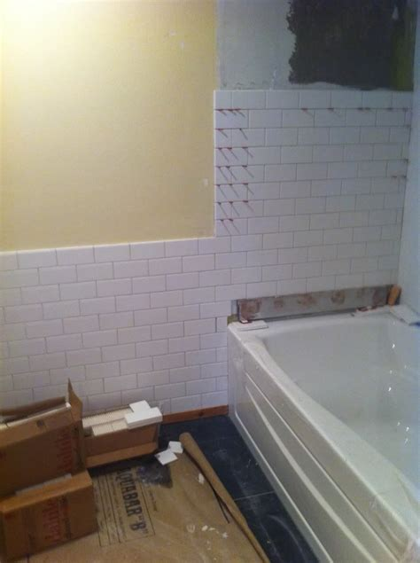 Tile Wainscoting Ideas by Subway Tile Transition From Wall Wainscot To Tub Cut