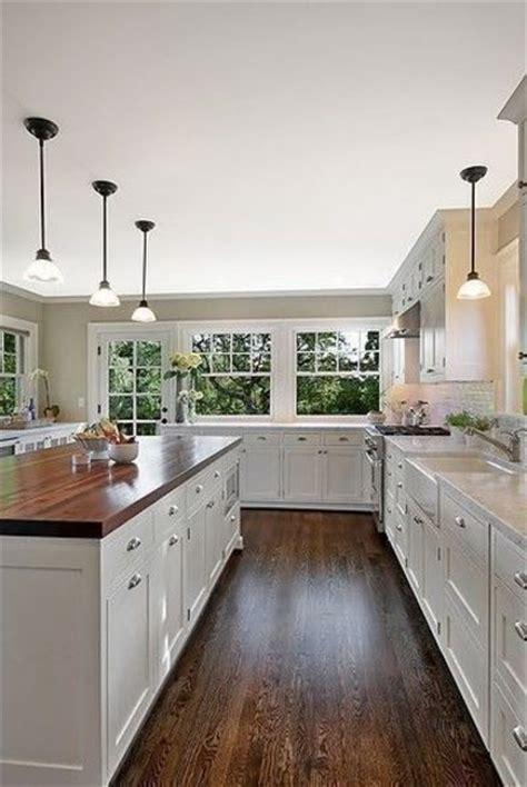 white cabinets dark hardwood floors butcher block