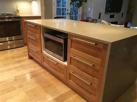 designed  ikea kitchen   custom island including ikeas quartz countertop  pebble