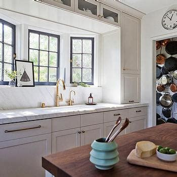 white kitchen  gold gooseneck faucet contemporary