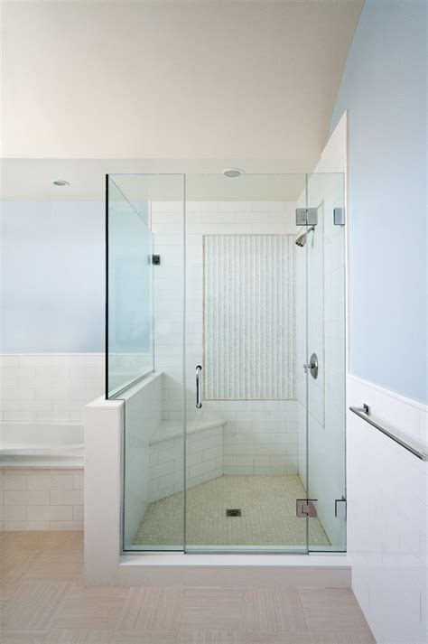 chic frameless shower door in bathroom traditional with