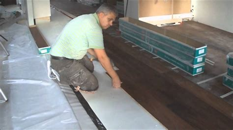 install floating floor concrete floating engineered hardwood floor and laminate installation how to mryoucandoityourself youtube