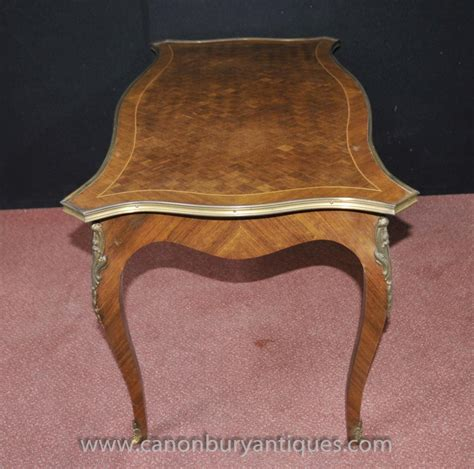 Our bountiful inventory of 18th, 19th, and 20th century french, english, italian, and continental antiques have all been restored with the highest of standards and are available to view online. French Empire Coffee Table Parquetry Inlay Tables