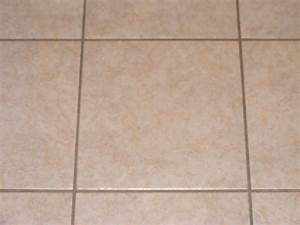 Light tile with dark grout best way to clean in floor for Cream floor tiles with grey grout