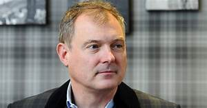 John Leslie returns home after police question him over ...